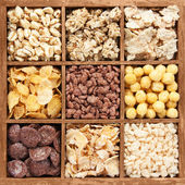 Assorted cereals in wooden box — Foto de Stock