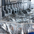 Details of a dishwasher (focus on the front row of glasses) - Stockfoto