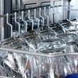 Details of a dishwasher (focus on the front row of glasses) - Stok fotoğraf