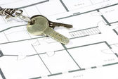 House key (with security hole code) on a paper plan — Stock Photo