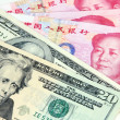 US dollar vs Chinese RMB — Stockfoto