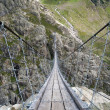 Stock Photo: Trift suspending bridge near Trift Glacier in Switzerland