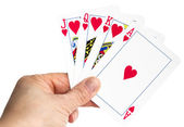 Hand holding playing cards with As and Heart as main interest — Photo
