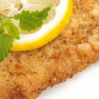 Viennese Schnitzel with lemon and lemon balm leaf — Stock Photo