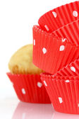 Muffin cups and muffin — Stock Photo