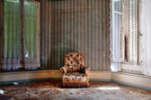 Sofa in an abandoned house — Stock Photo