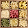 Assorted pastas in wooden box — Stock fotografie