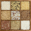 Assorted rices in wooden box — Stock Photo