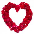 Heart shape ring formed by red rose petals — Stockfoto