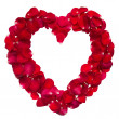 Heart shape ring formed by red rose petals — Stock Photo
