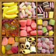 Assorted candy in wooden box — Stok Fotoğraf #27077287
