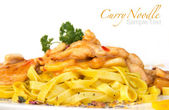 Curry noodle with chicken meat on white background — Stock Photo