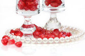 Pearl bracelet with red pomegranate seeds — Stock Photo