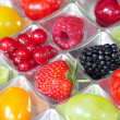Different fresh fruits in a chocolate box — Stock Photo