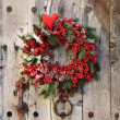 Christmas wreath on an old wood door — Stock Photo
