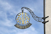 Classic hotel sign against blue sky — Stock Photo