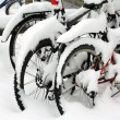 Snow covered bicycles in the street — Stock Photo