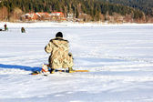Fishing on the frozen lake — Stock Photo