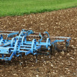 Blue plough in field — Stock Photo #37983123