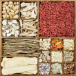 Chinese herb medicines in a rustic wooden box — Stock Photo
