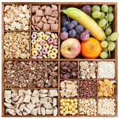 Assorted cereals in wooden box with fresh fruits — Stock Photo