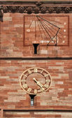 Sundial and clock on Basel Cathedral, Switzerland — Stock Photo