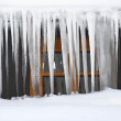 Icicles hanging over the roof in a severe winter — Stock Photo #39148675