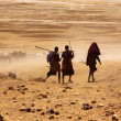 Massai boys driving cows to drink water — Stock Photo