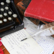 Classic type writer with old postcards and feather pen — Stock Photo #46149701
