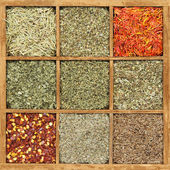 Spices in rustic wooden box — Stock Photo