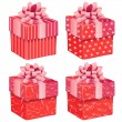Four pink gift boxes — Stock Vector