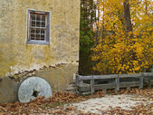 Millstone and Wall — Stock Photo