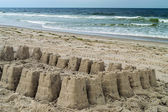 Sand Castle and Surf — Stock Photo