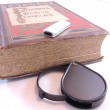 Magnifying glass and old books — Stock Photo #18126393