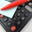 Calculator with note pad — Stock Photo #20832043