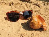 Glasses on sand — Stock Photo