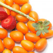 Stock Photo: Strawberry and kumquats