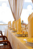 Dishware and Glass on Banquet Table — Stock Photo