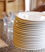 Plates with Empty Gloss on Table — Stock Photo