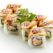 Roll made of Salmon, Cream Cheese and Avocado inside. Topped with Smoked Eel — Stock Photo #23468600