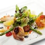 Fried Seafood Salad with Lemon Slice and Asparagus — Stock Photo