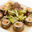 Japanese Cuisine - Deep-fried Sushi Roll with Salmon and Lettuce inside — Stock Photo #23472274
