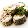 Japanese Cuisine - Deep-fried Sushi Roll with Salmon and Lettuce inside — Stock Photo