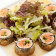 Japanese Cuisine - Deep-fried Sushi Roll with Salmon and Lettuce inside. Served with Salad Leaf and Sauce — Stock Photo #23478108