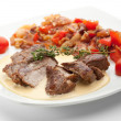 Medallions of pork with beans and salsa — Stock Photo