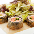 Japanese Cuisine - Deep-fried Sushi Roll with Salmon and Lettuce inside. Served with Salad Leaf and Sauce — Stock Photo