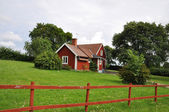 Old red cottage — Stock Photo