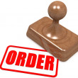 Order word on wooden stamp — Stock Photo