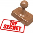 Top secret word on wooden stamp — Stock Photo