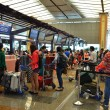 Tourists queue in fronts of ticket counter at Singapore airport — Stock Photo #34675251